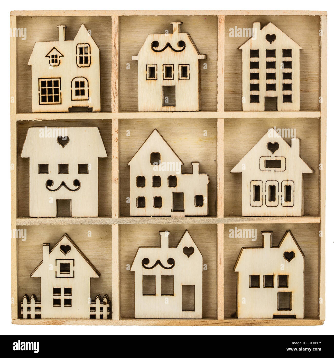 Set of wooden facade houses in box, isolated on white background - Stock Image