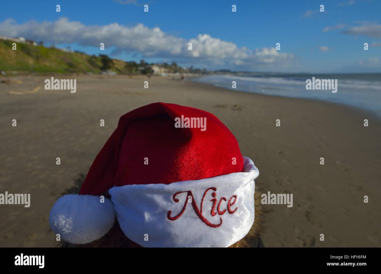 Nice Santa Claus at Christmas on the Seacliff state beach, Aptos CA - Stock Image