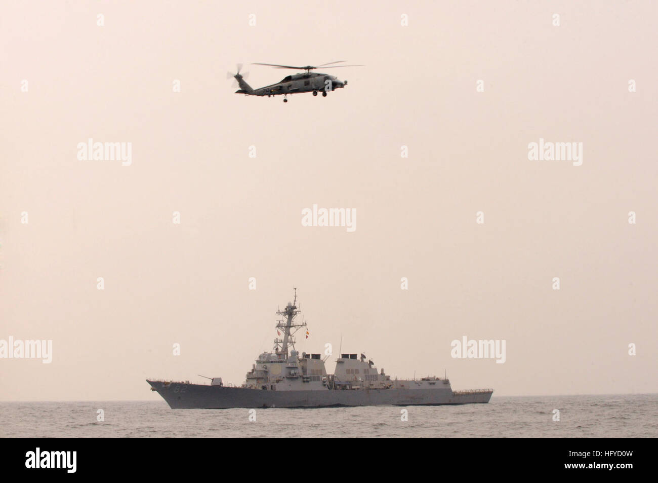 101014-N-7478G-205 SEA OF JAPAN  (Oct. 14, 2010) The guided-missile destroyer USS Lassen (DDG 82) and an SH-60F - Stock Image
