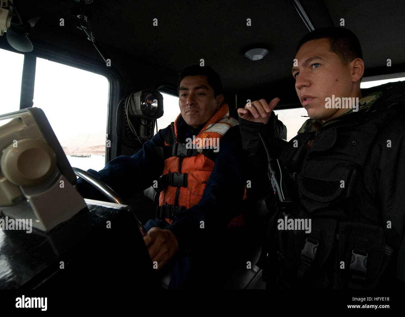100921-N-9095H-056  LIMA, Peru (Sept. 21, 2010) Boatswain's Mate 1st Class Edwin Mantilla, right, security force Stock Photo