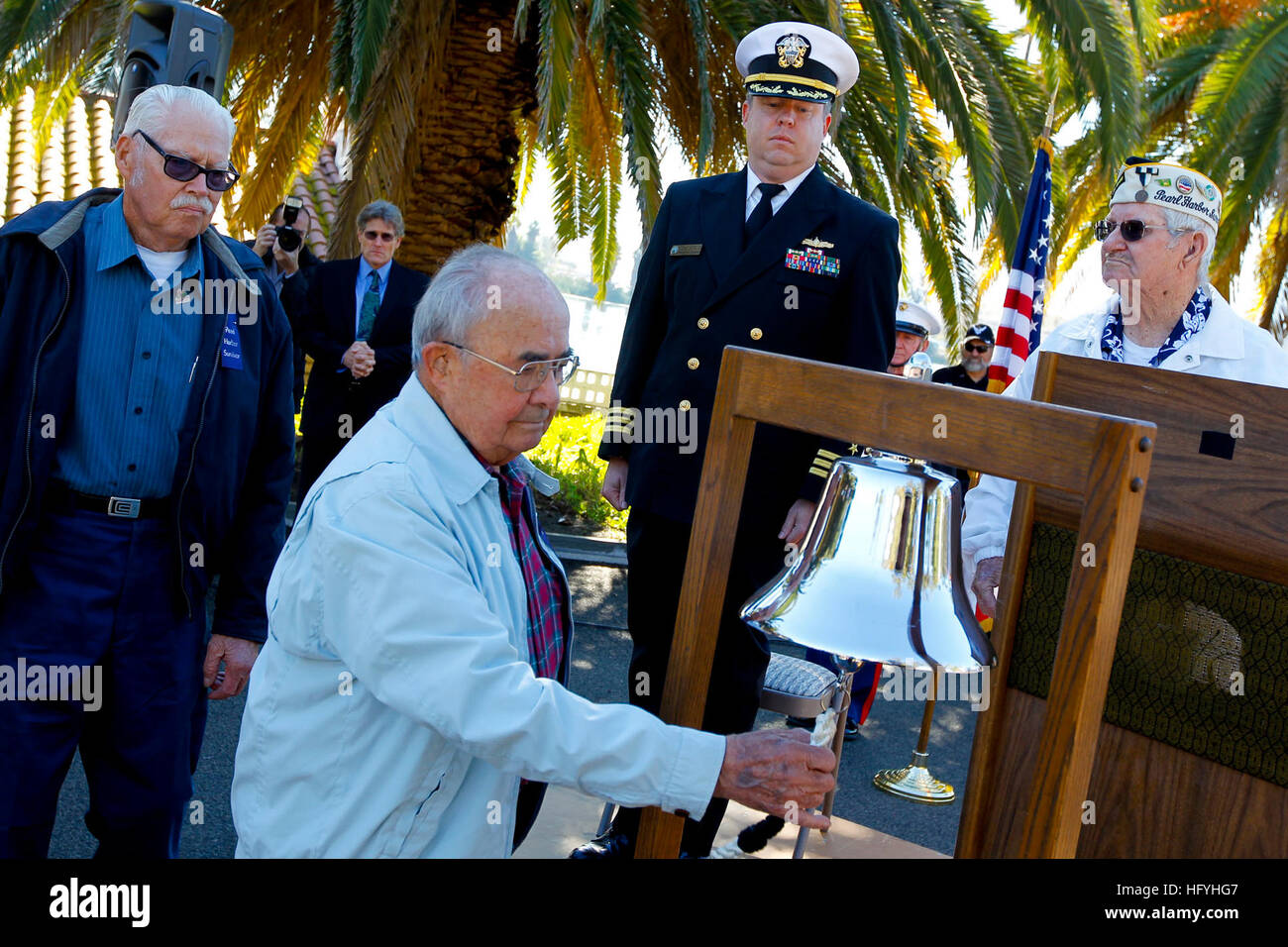 101207-N-8863V-497 NORCO, Calif. (Dec. 7, 2010) Roger Marron, 90, center, rings a bell at Naval Surface Warfare - Stock Image