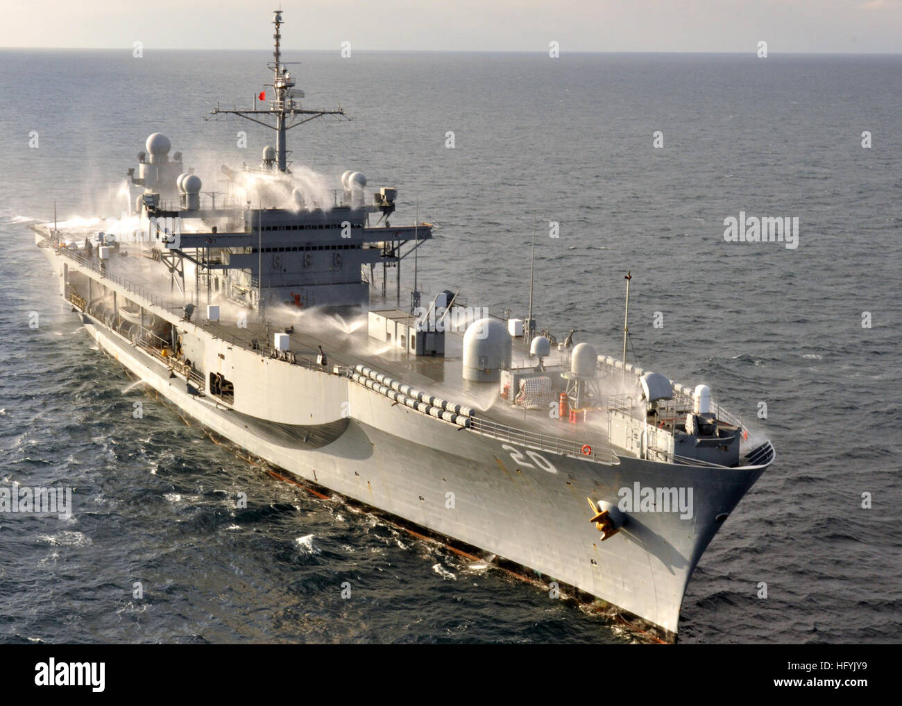 The amphibious command ship USS Mount Whitney (LCC/JCC 20) tests of the ship's salt water countermeasure wash - Stock Image
