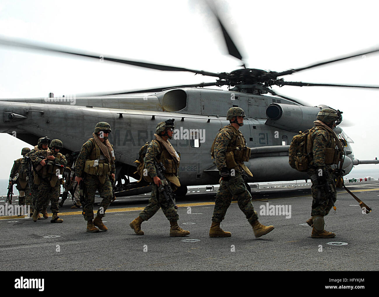 Marines assigned to the 31st Marine Expeditionary Unit debark from a CH-53E Sea Stallion helicopter aboard the forward - Stock Image