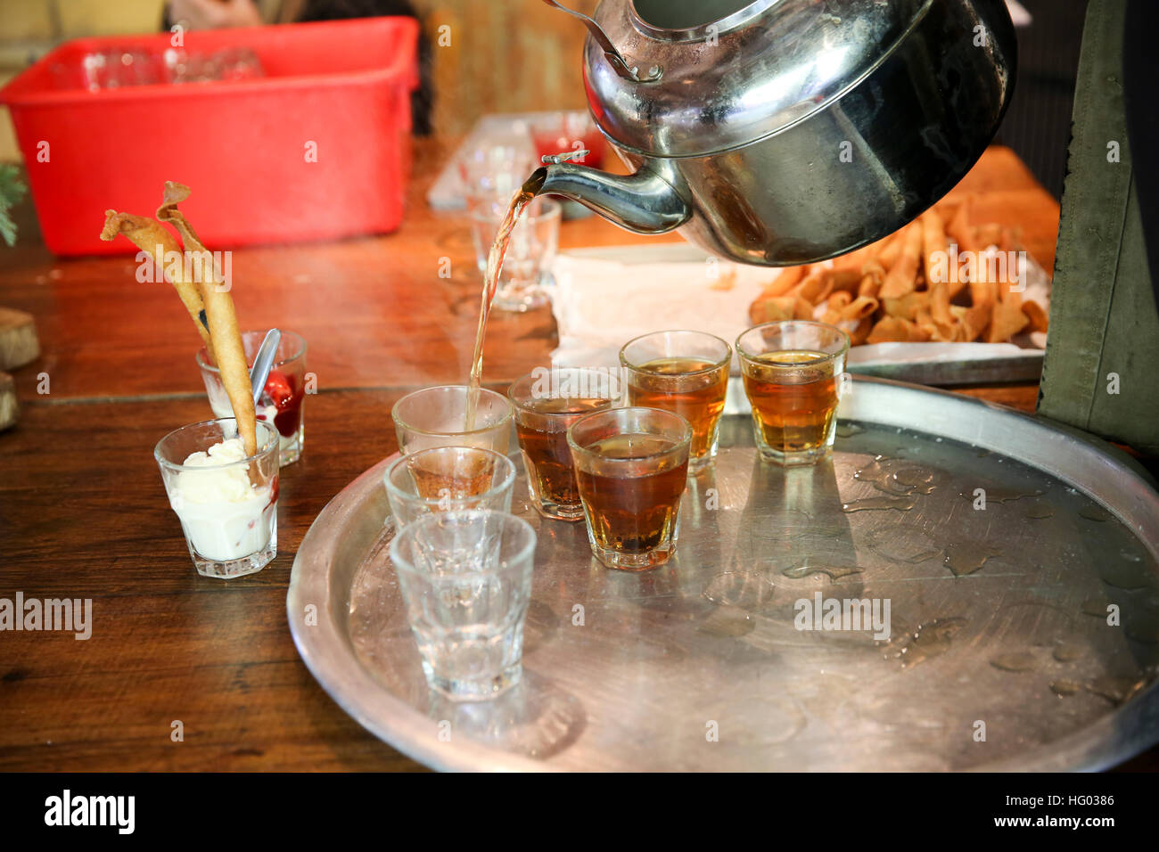 Mid eastern Hospitality - serving tea to visitors. - Stock Image
