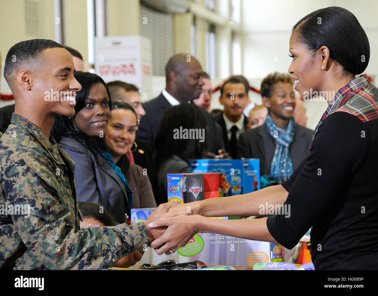 111216-F-ZE674-348 WASHINGTON (Dec. 16, 2011) First lady Michelle Obama shakes hands with Lance Cpl. Aaron Leeks Stock Photo