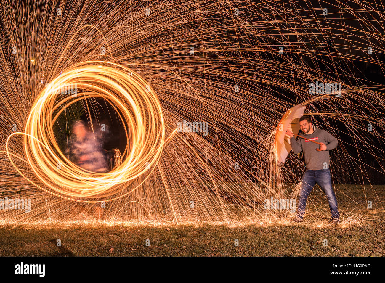 Steel wool photography with an umbrella Stock Photo