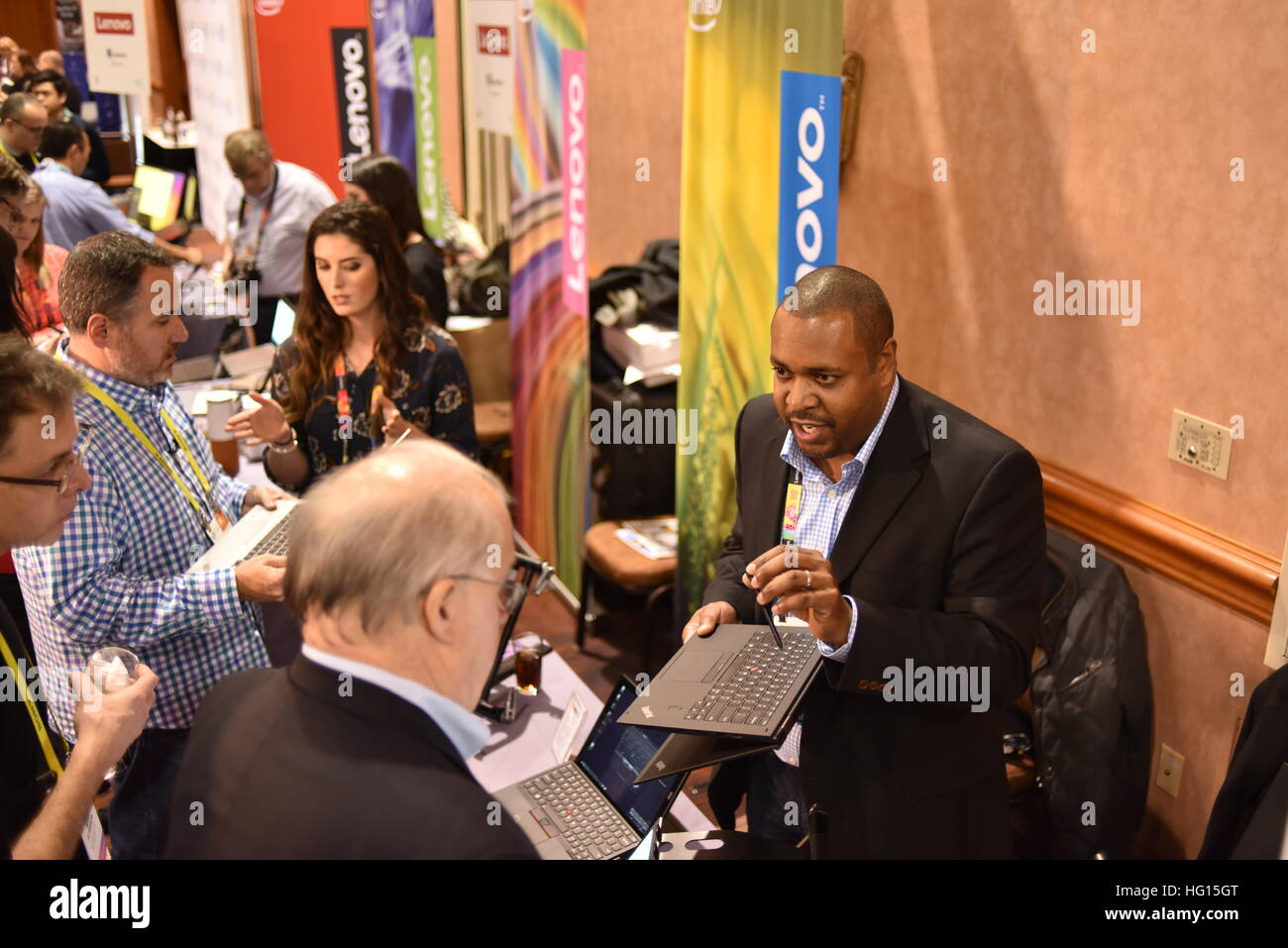 Las Vegas, Nevada, 3rd Jan, 2017.  People gather around Lenovo's booth during 'CES Unveiled,' a media - Stock Image