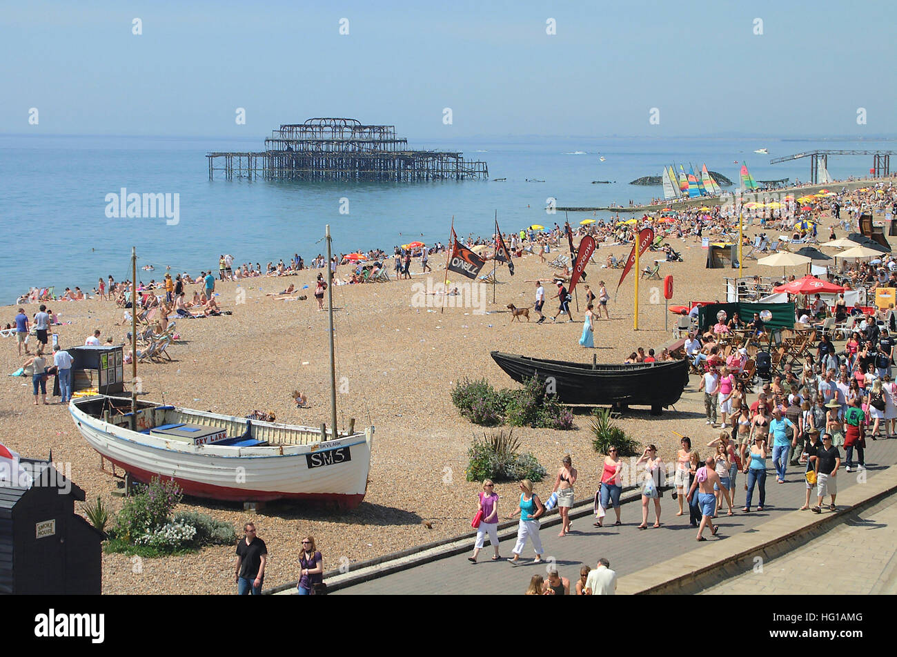 Fishing boats display on Brighton seafront with the remains of old west pier in the background. Sussex, England. Stock Photo
