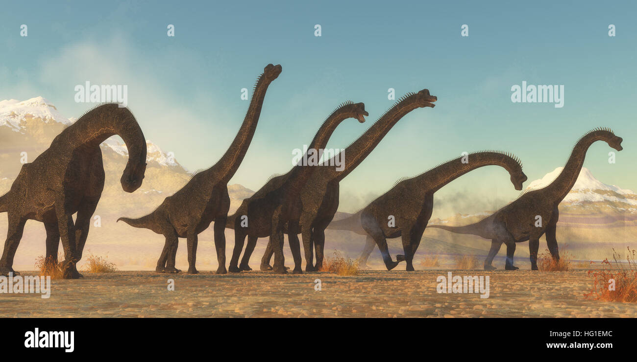 A Brachiosaurus dinosaur herd pass through a dry desert area in the Jurassic Period of North America. Stock Photo