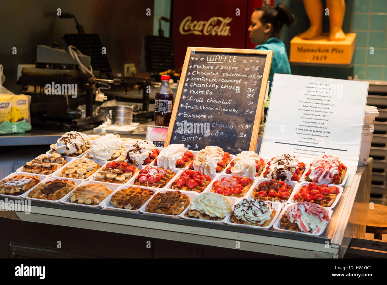 Belgian waffles with chantilly cream chocolate and strawberries on sale in Brussels, Belgium - Stock Image