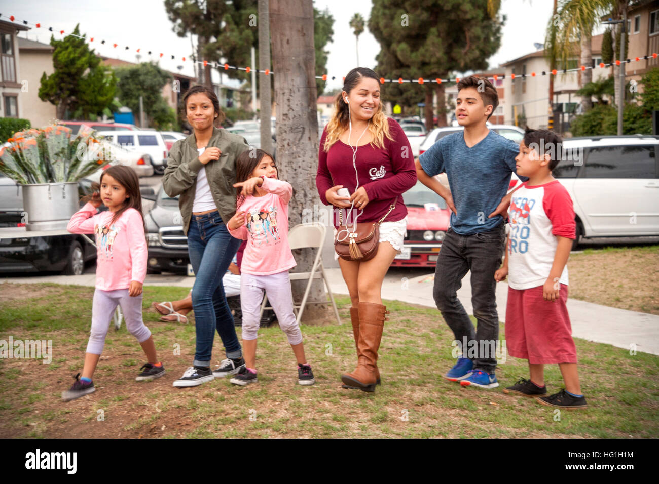 Local families arrive to help prepare for Dad of the Dead ceremonies in a Hispanic community in Huntington Beach, - Stock Image