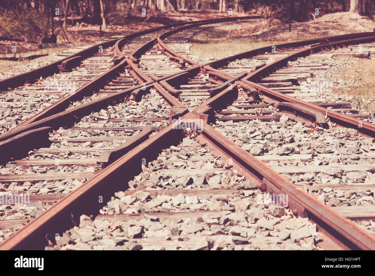 A view of a junction on old railroad tracks - Stock Image