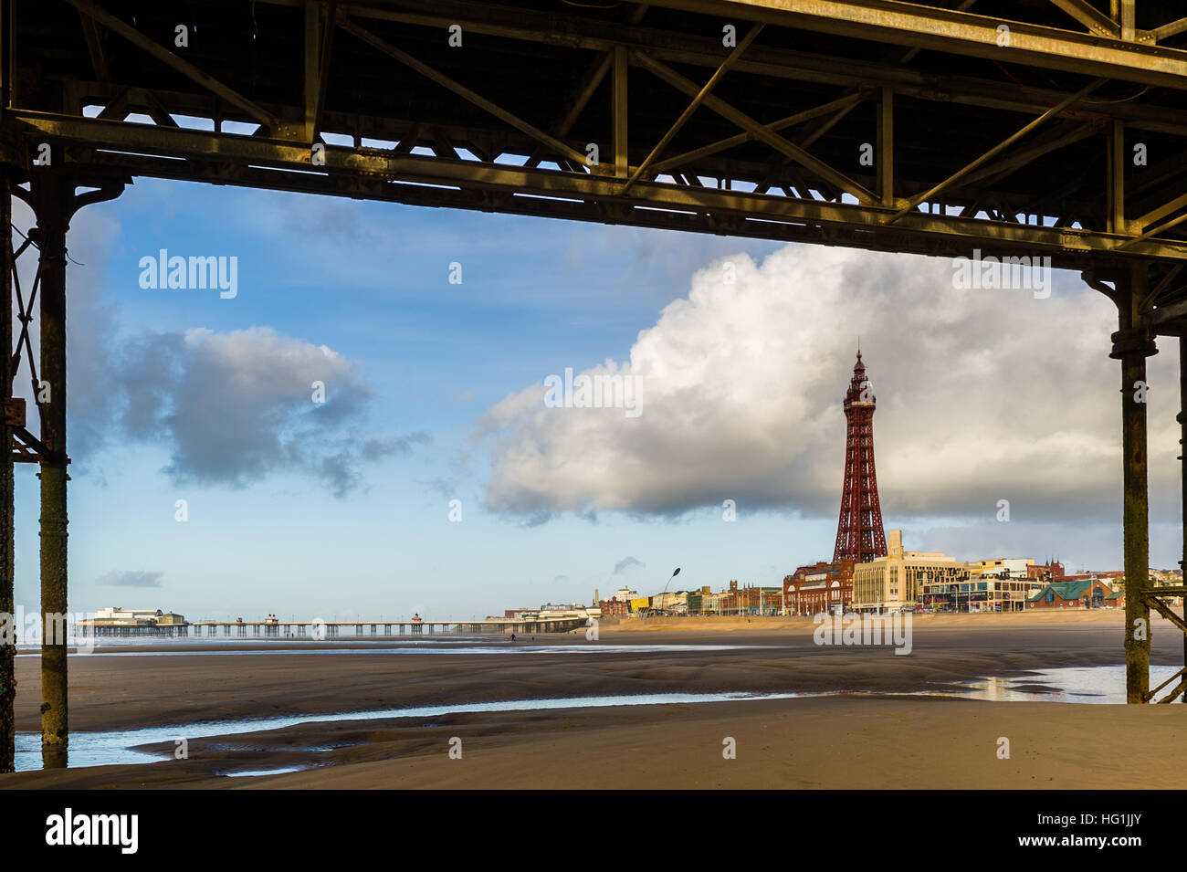 Blackpool Tower is pictured from under Central Pier, Blackpool, Lancashire, United Kingdom. - Stock Image