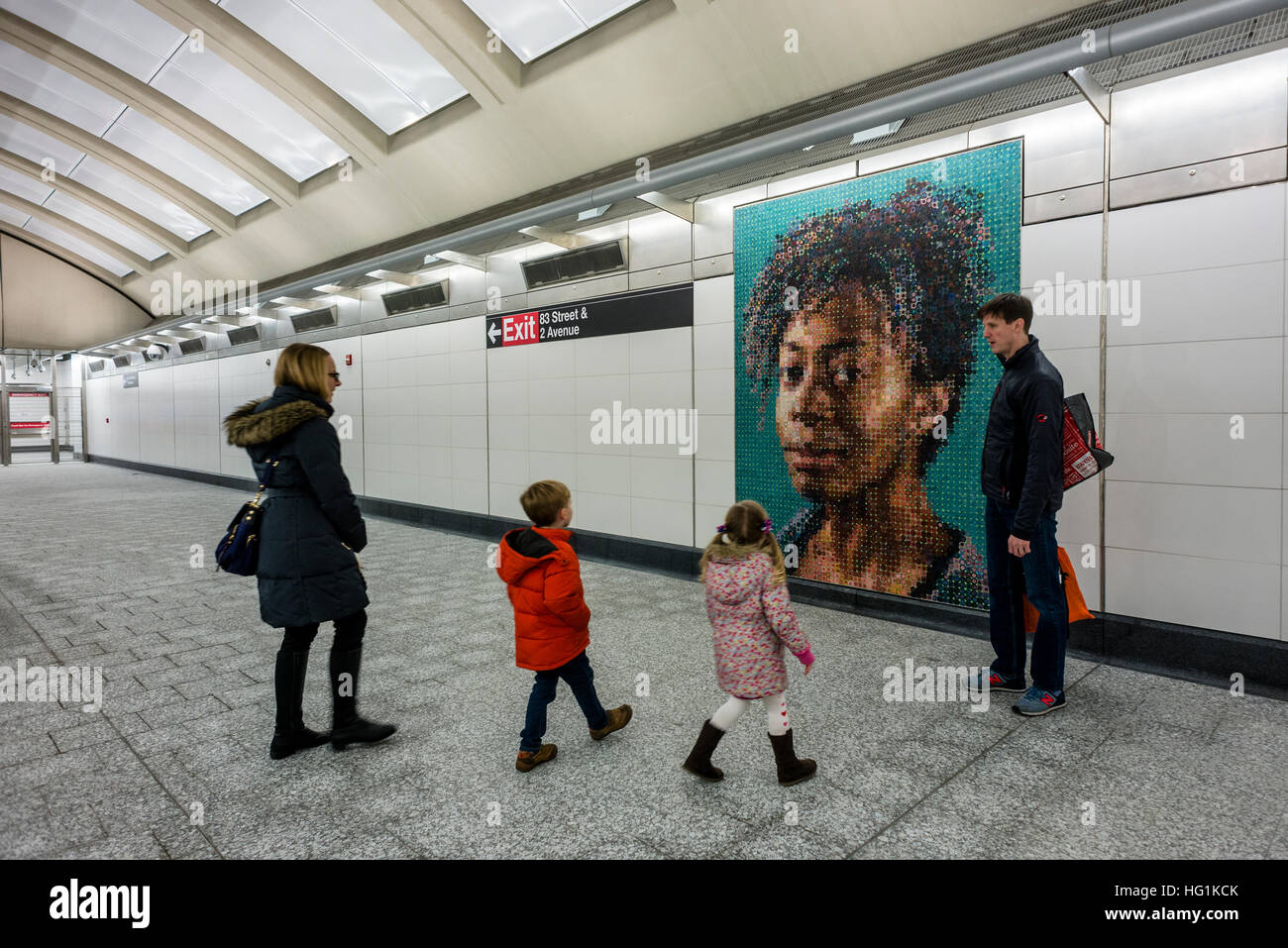 New York, USA 1 January 2017 - An African American couple admires a mosaic mural by Vik Muniz at the 72nd St Station - Stock Image