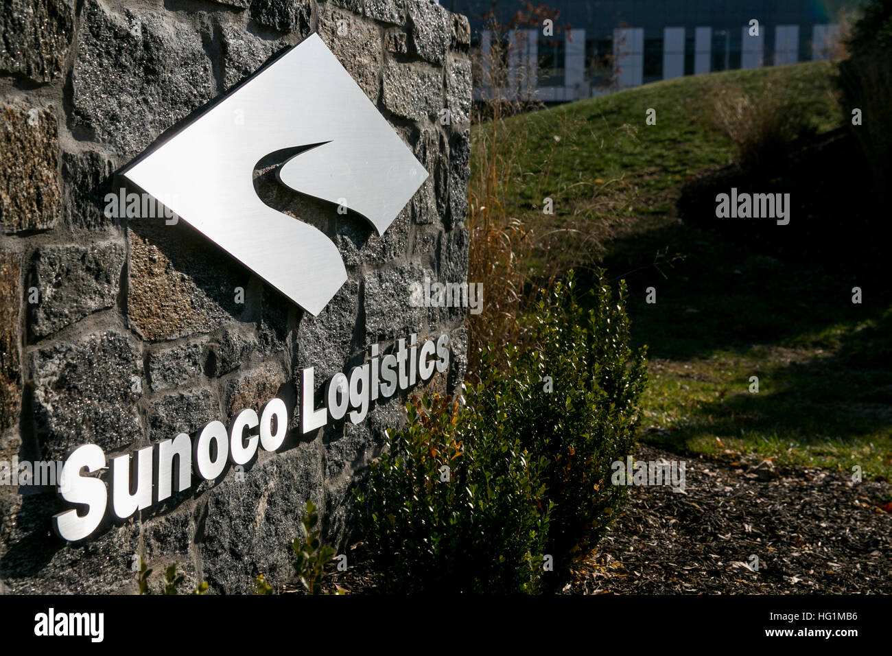 A logo sign outside of a facility occupied by Sunoco Logistics Partners LP, in Newtown Square, Pennsylvania on December - Stock Image