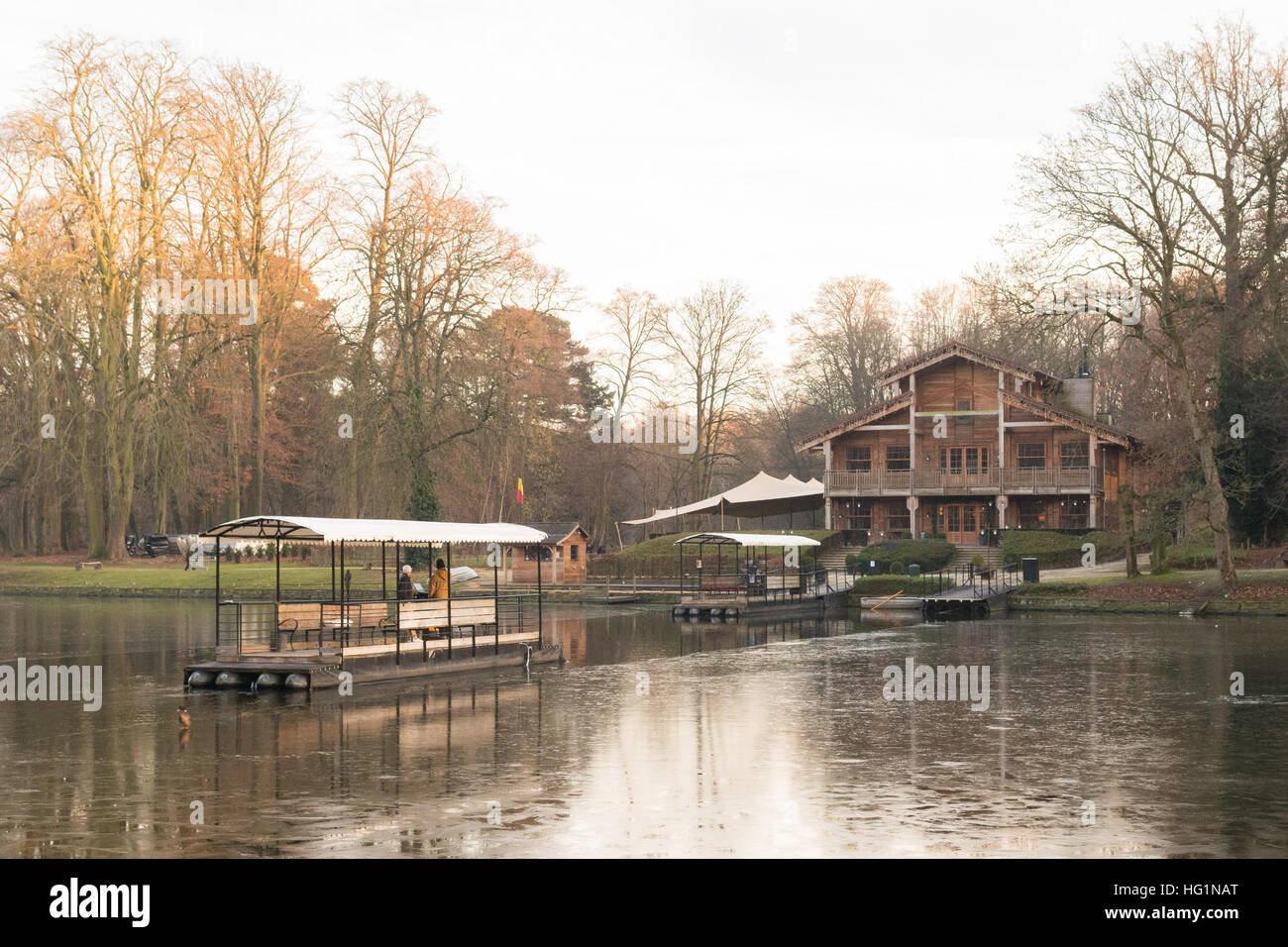 boat crossing over to Chalet Robinson, island restaurant on Bois de la Cambre in the Sonian Forest, Brussels, Belgium - Stock Image