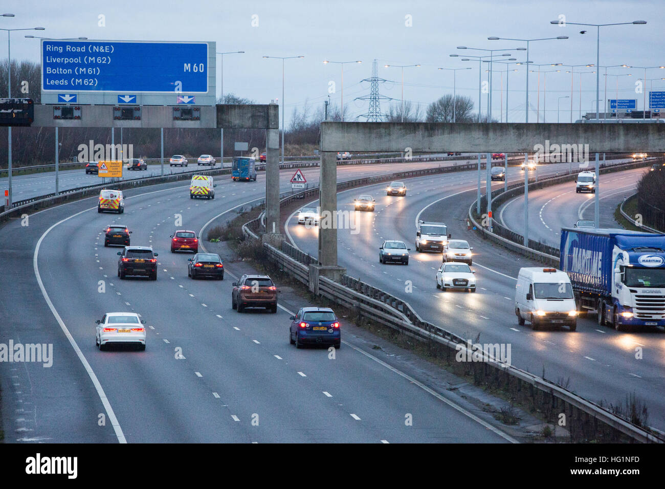 Busy traffic on the M60 motorway in Manchester near Sale - Stock Image