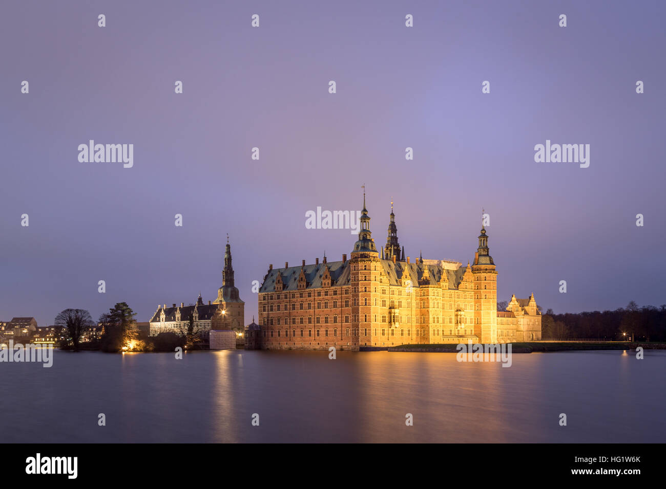 Hillerod, Denmark - December 29, 2016: View of the illuminated Frederiksborg Palace - Stock Image