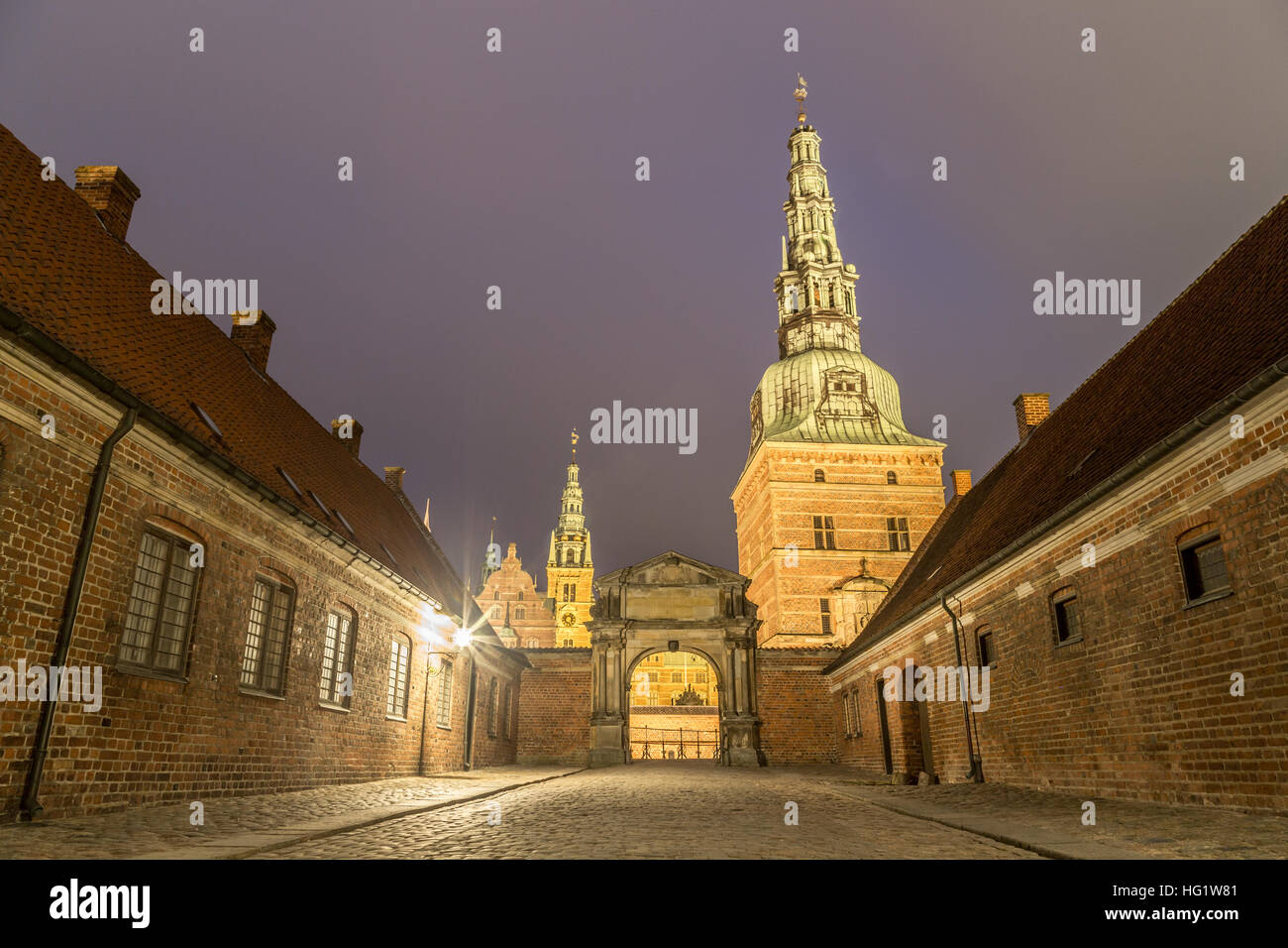 Hillerod, Denmark - December 29, 2016: View of the illuminated entrance gate to Frederiksborg Palace - Stock Image