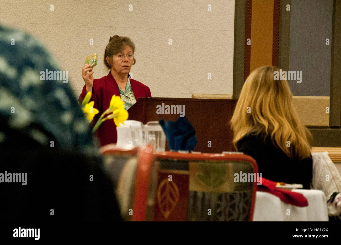 Ms. Laura Kneib, creator of From Re-claimed Oil and Glycerin Soap, gives an inspirational speech during a Women's - Stock Image