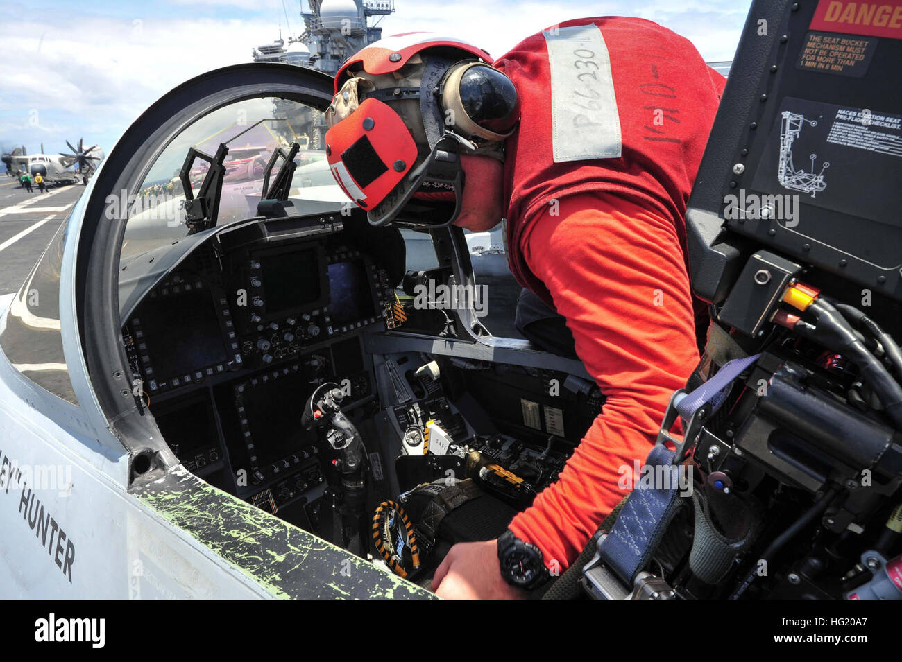 Aviation Ordnanceman Airman Corey Langsdorf, a Winfield, W.V., native assigned to the 'Gauntlets' of Electronic - Stock Image