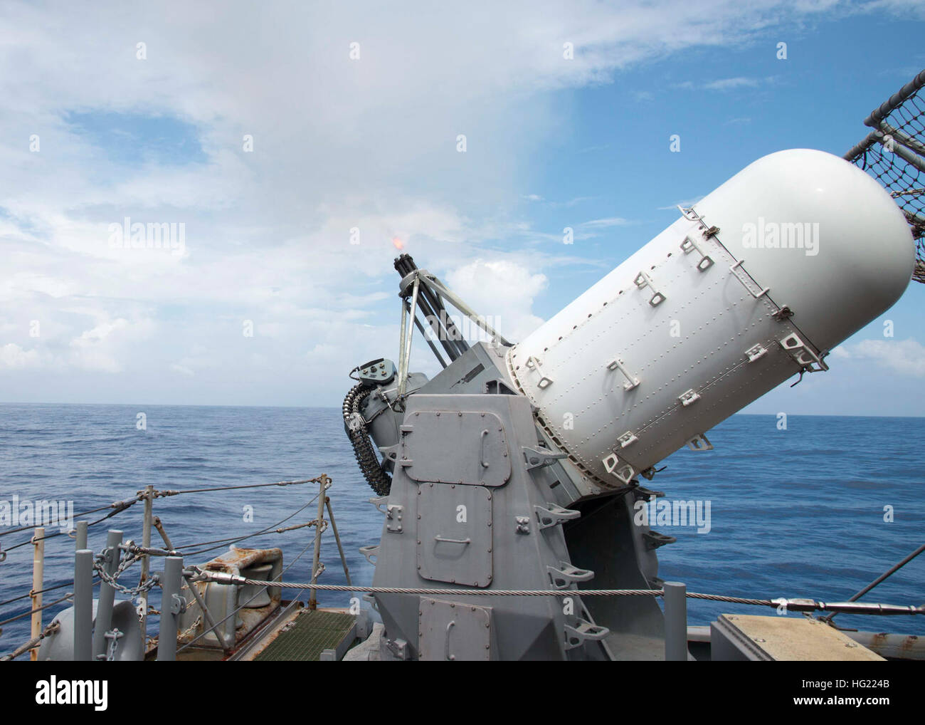 The close-in weapons system (CIWS) aboard the amphibious assault ship USS Peleliu (LHA 5) successfully fires upon - Stock Image