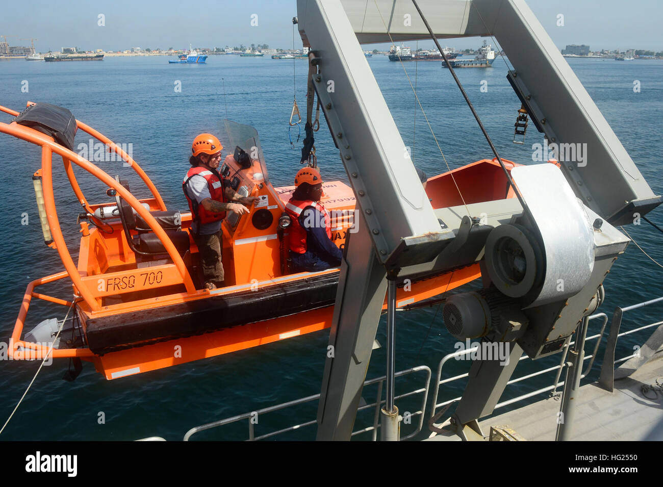 150306-N-RB579-022 LUANDA, Angola (March 6, 2015) Civil service mariners conduct boat recovery operations aboard - Stock Image