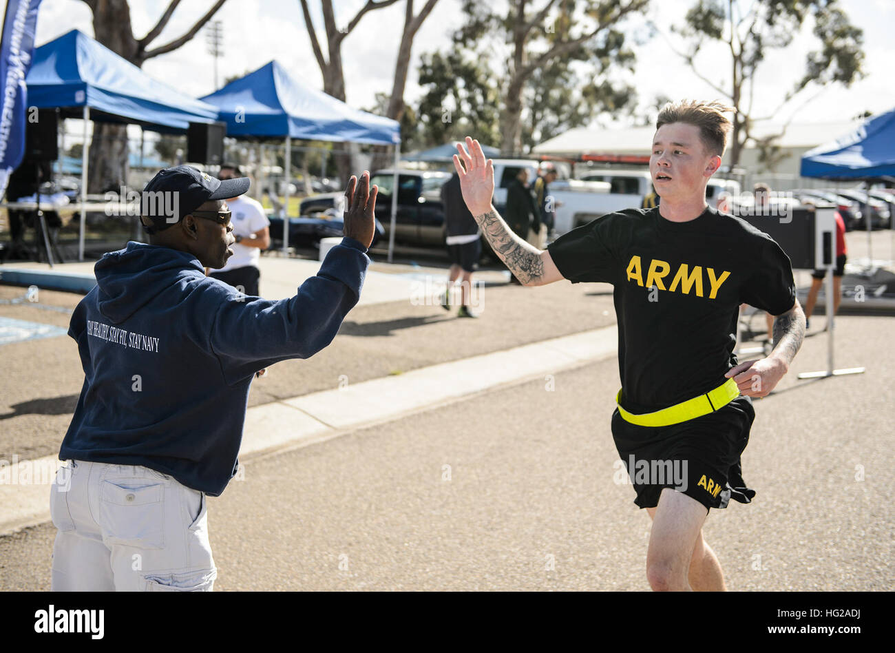 NAVAL BASE SAN DIEGO (Nov. 10, 2015)  Servicemembers cheer each other on during an MWR Veterans Day run or walk. - Stock Image