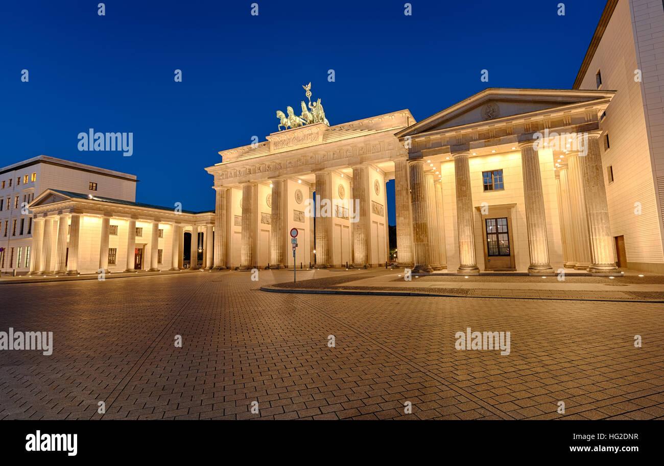 The famous Brandenburger Tor in Berlin illuminated at night - Stock Image