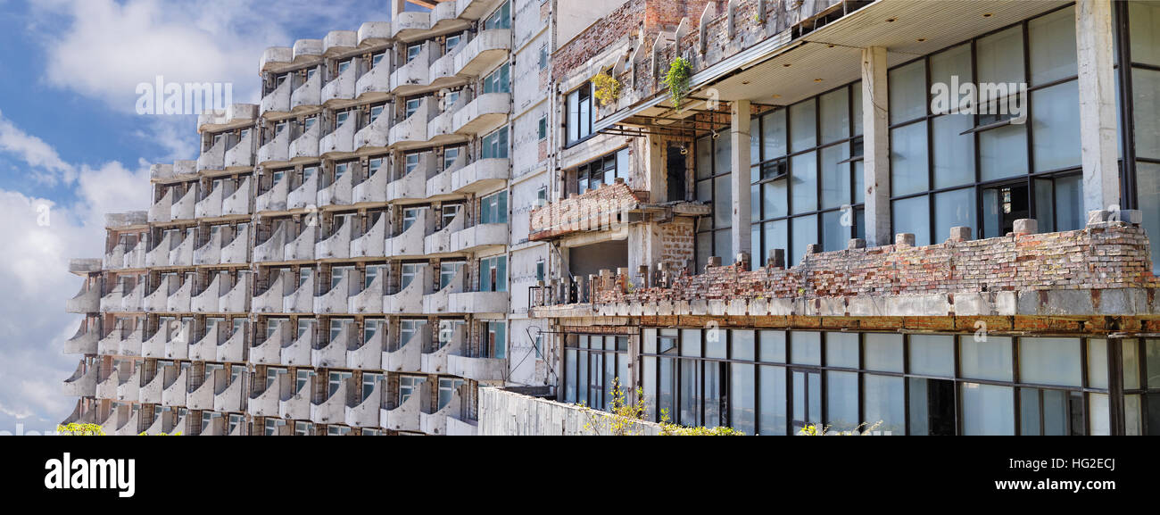 Abandoned apartment building, post-apocalyptic panoramic image in Crimea - Stock Image