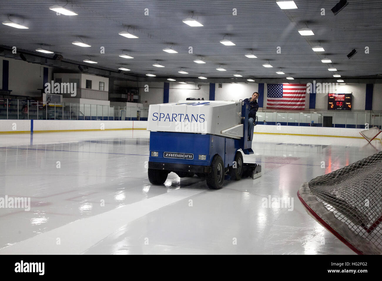 Zamboni repairing rutted ice from hockey game note American flag on back wall. St Paul Minnesota MN USA - Stock Image