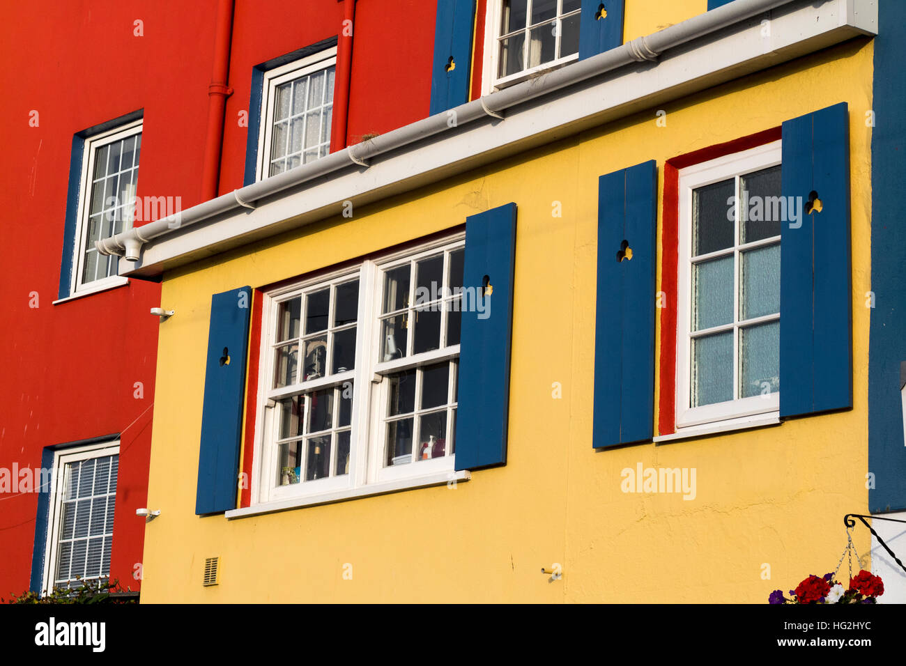 Bright Colored Walls, Windows, and Shutters on Buildings in Stock ...