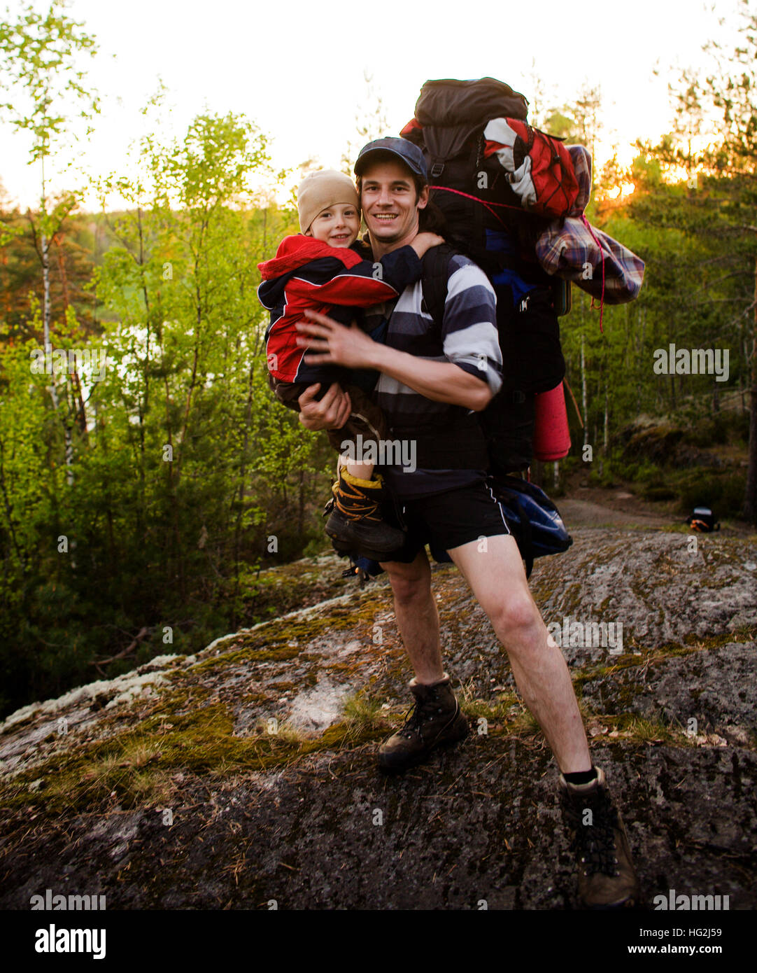 b31c5017f6c2 young happy father traveling with little son and huge backpack Stock ...