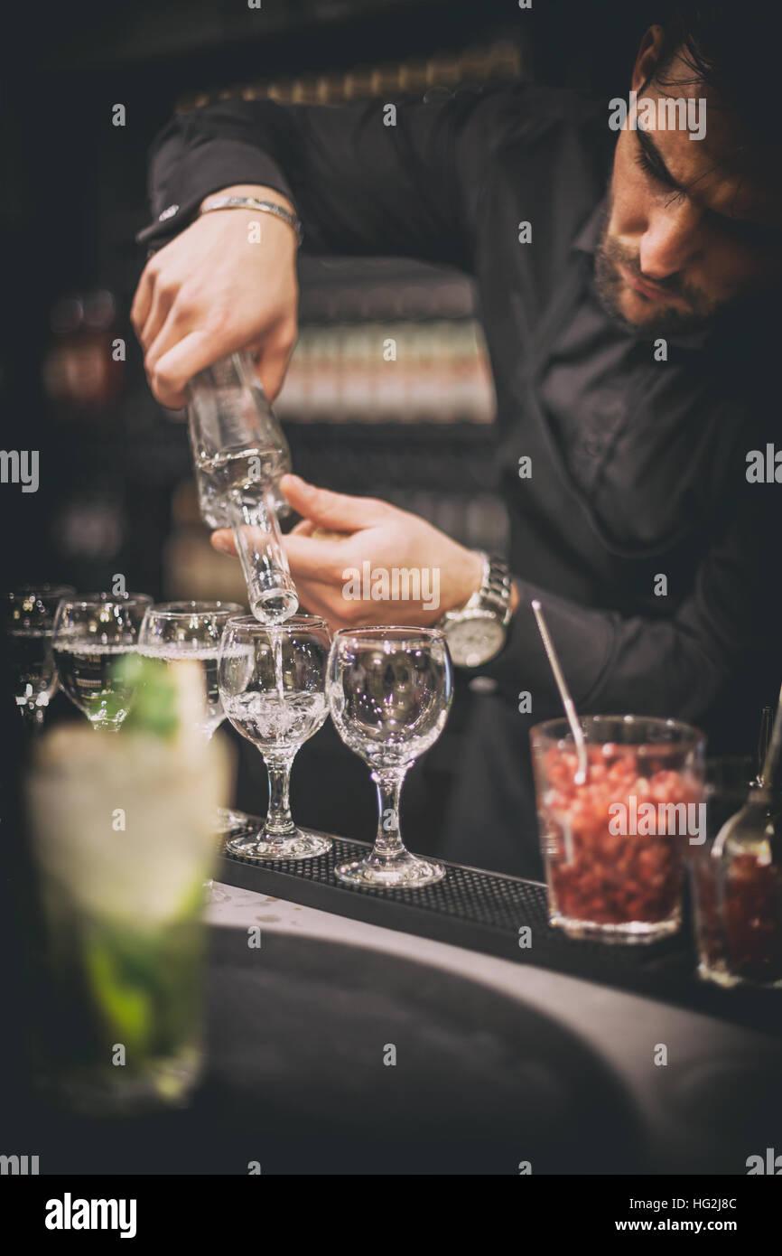 Barman at work, preparing cocktails - Stock Image