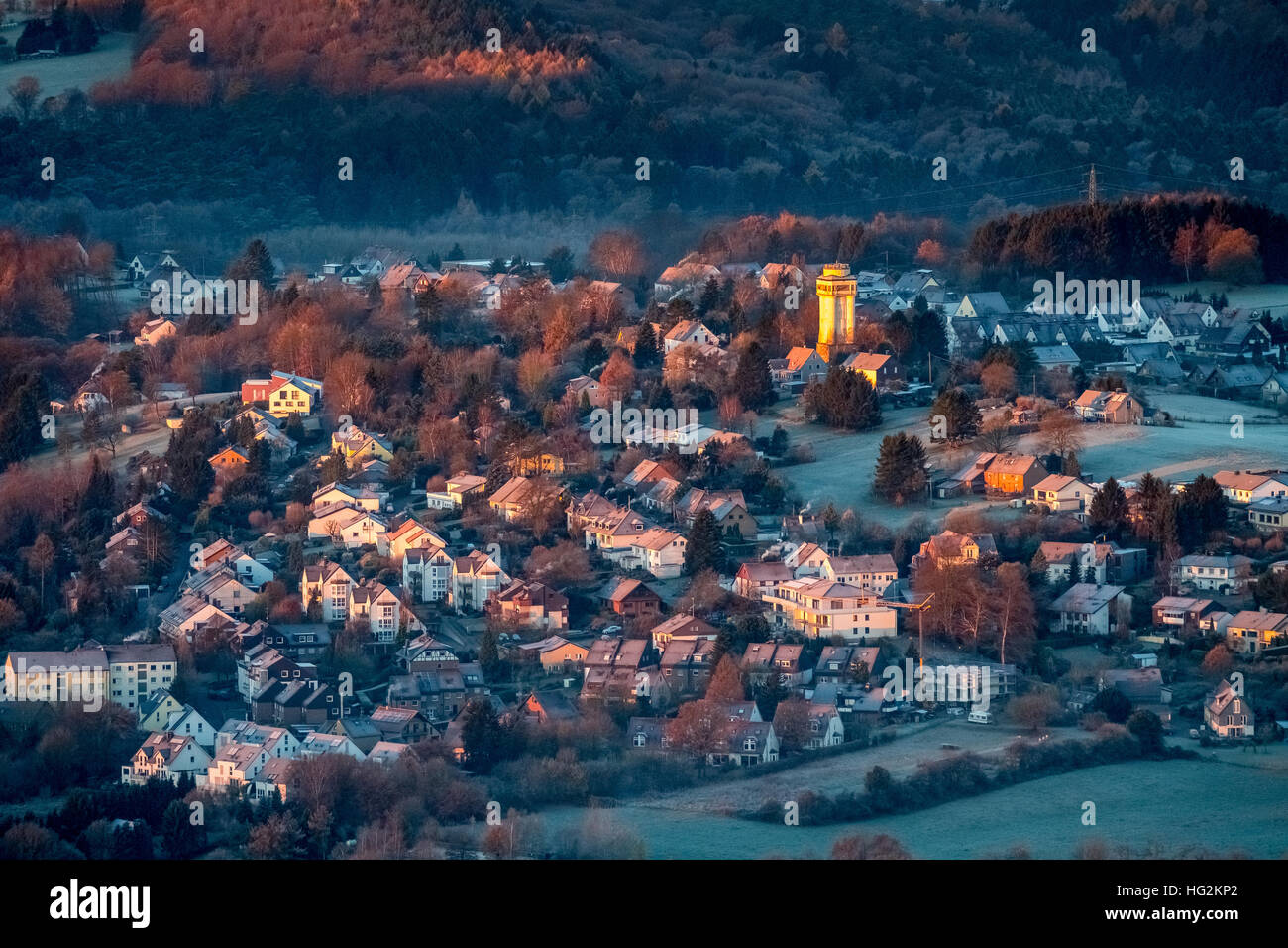 Aerial view, The old water tower in Bommern shines at sunrise, when the rest Bommerns is still in the shadow. , - Stock Image