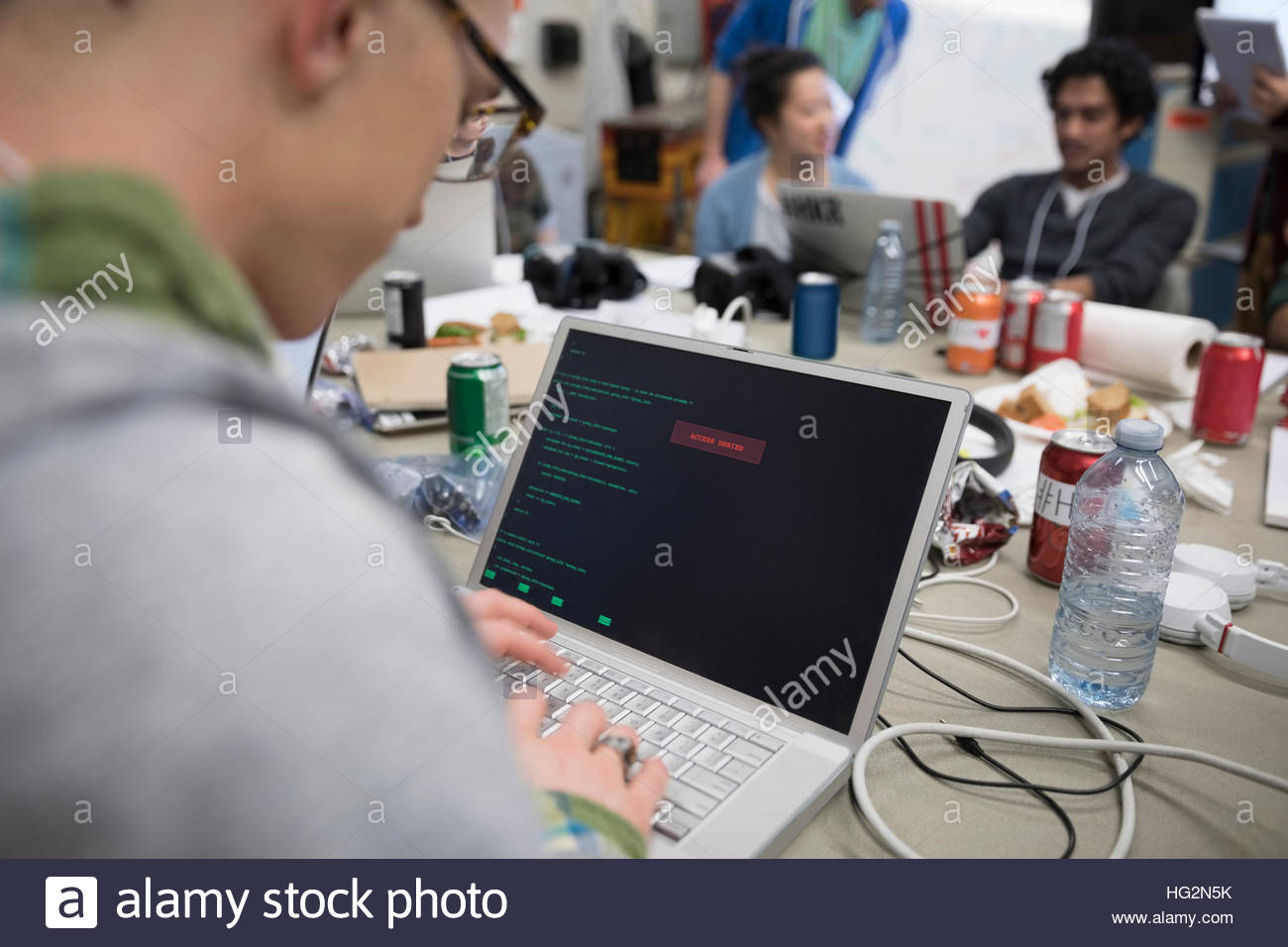 Hacker coding working hackathon at laptop - Stock Image