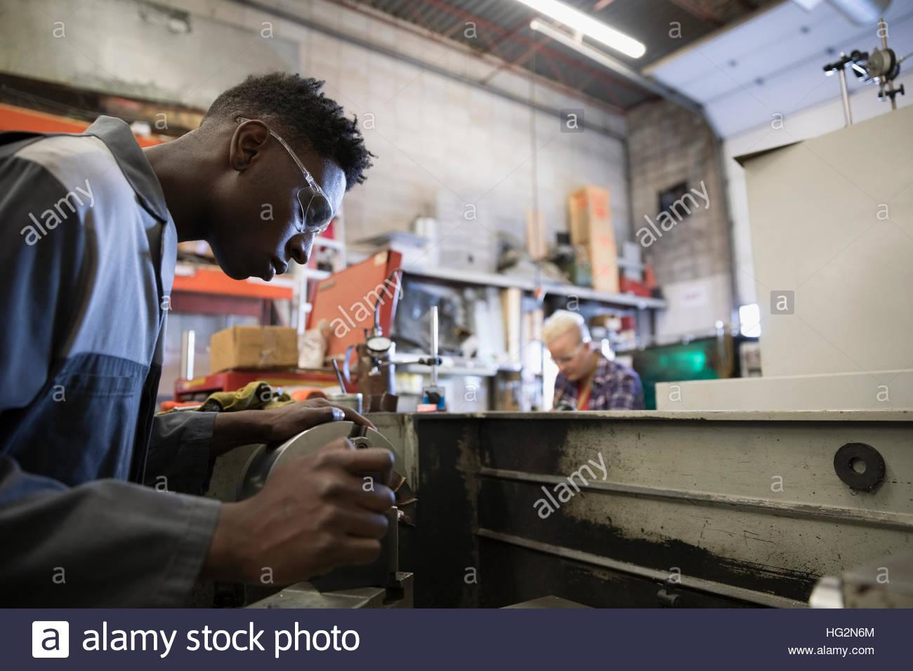 Design professional engineer using equipment in workshop - Stock Image
