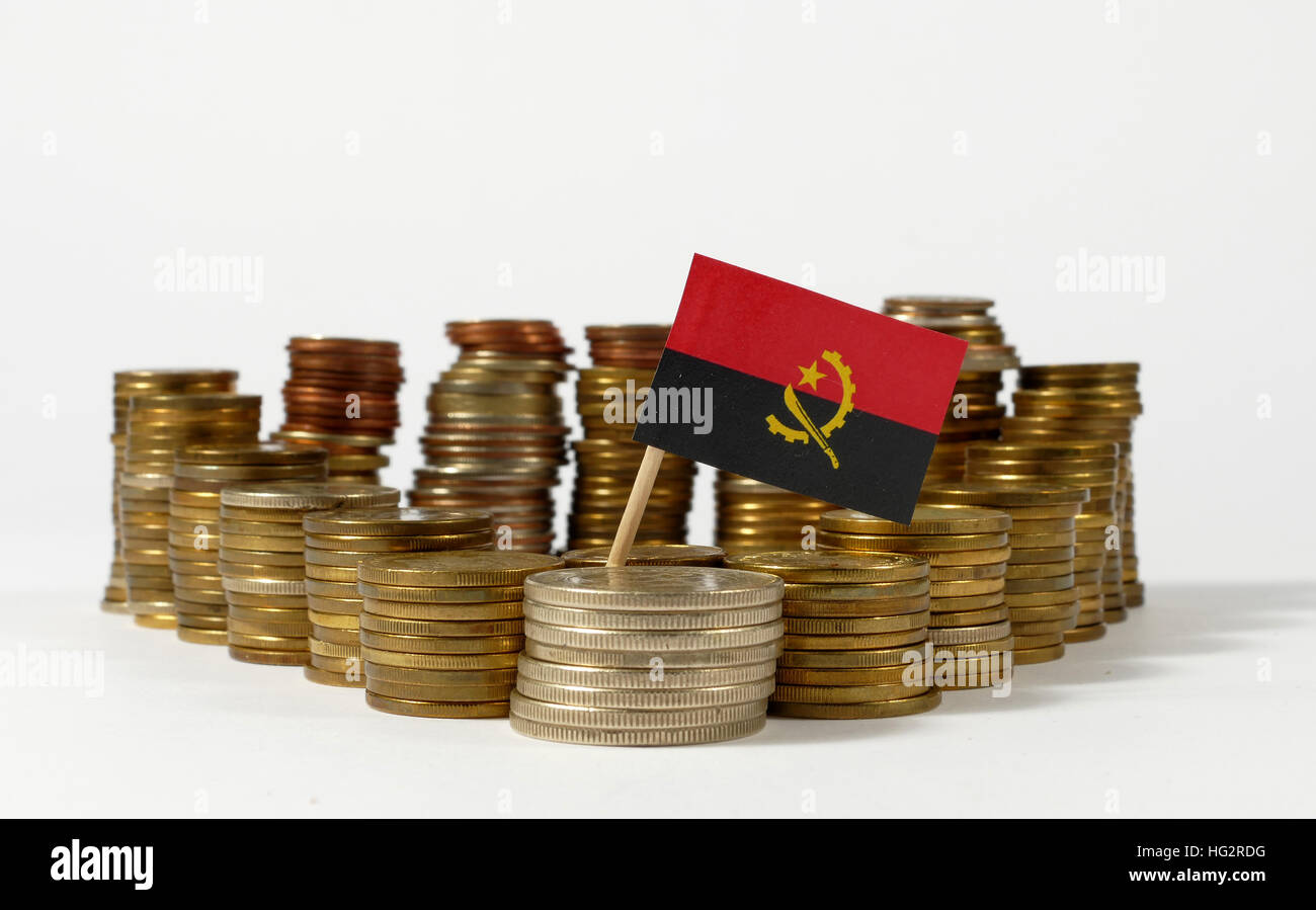 Angola flag waving with stack of money coins - Stock Image