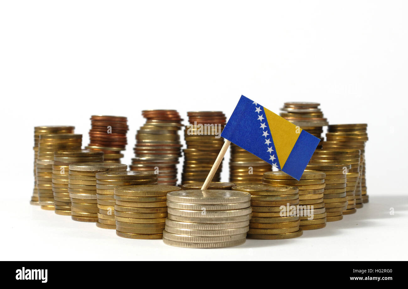 Bosnia and Herzegovina flag waving with stack of money coins - Stock Image