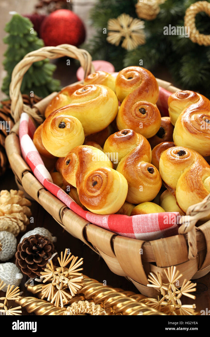 homemade swedish saffron buns, lussekatt in basket - Stock Image