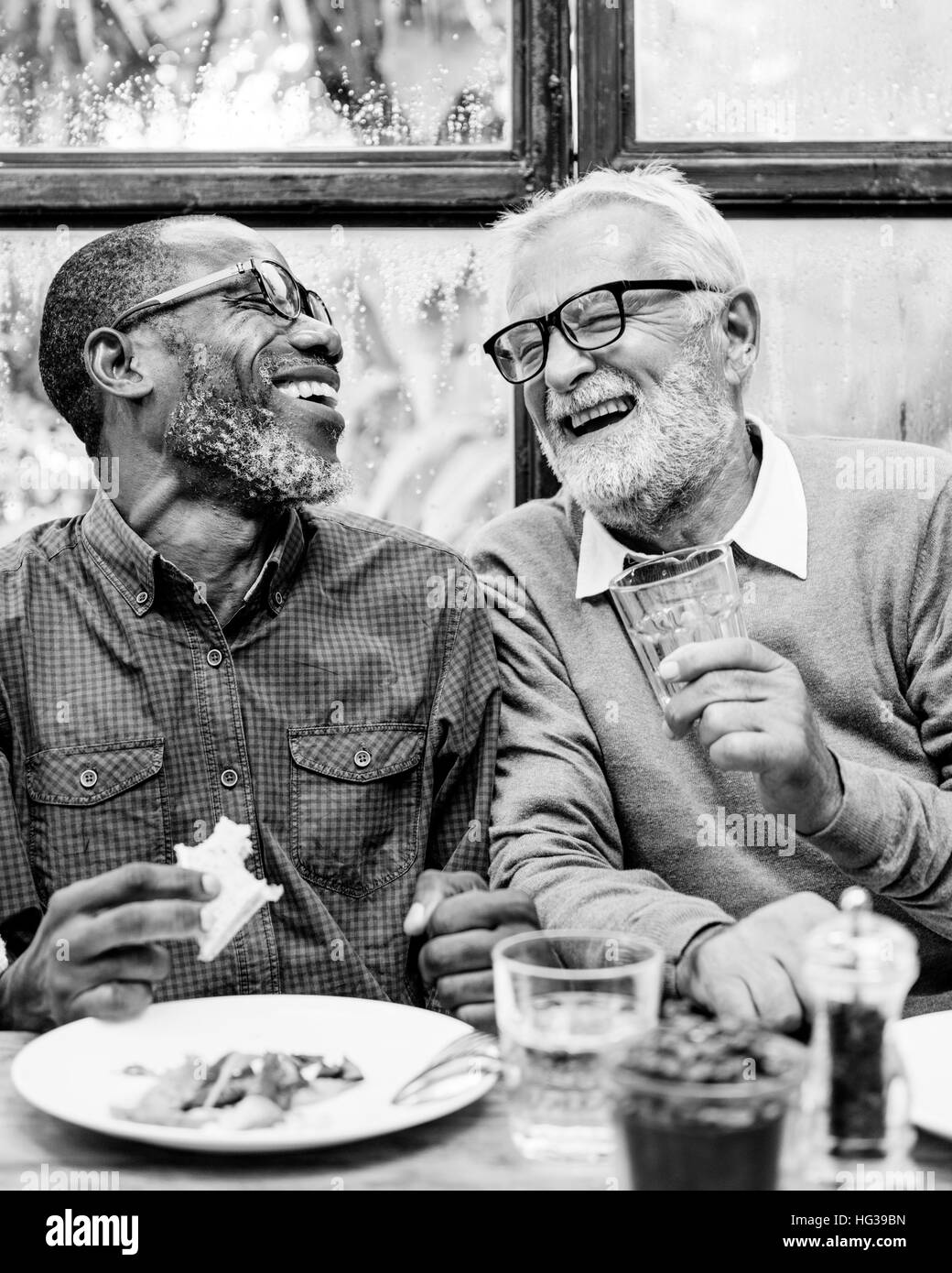 Group of older people drinking black and white stock photos images