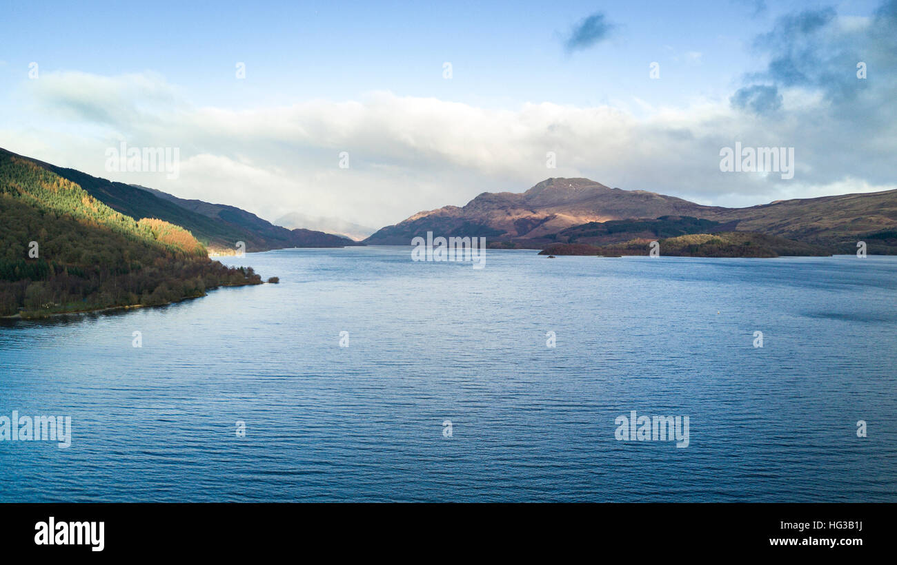 An aerial view of Loch Lomond in the Scottish Highlands.  The mountain of Ben Lomond ac be seen right of centre. - Stock Image