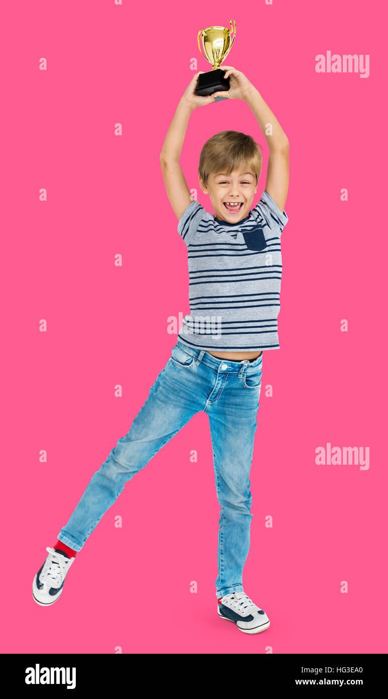 Boy Won Award Reward Cup Prize Concept - Stock Image