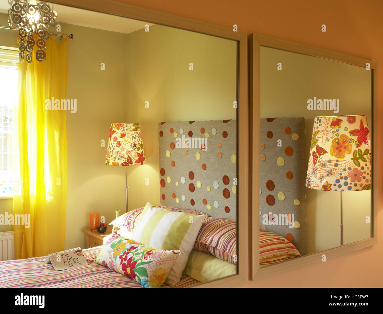 Bedroom reflected in mirrors - Stock Image