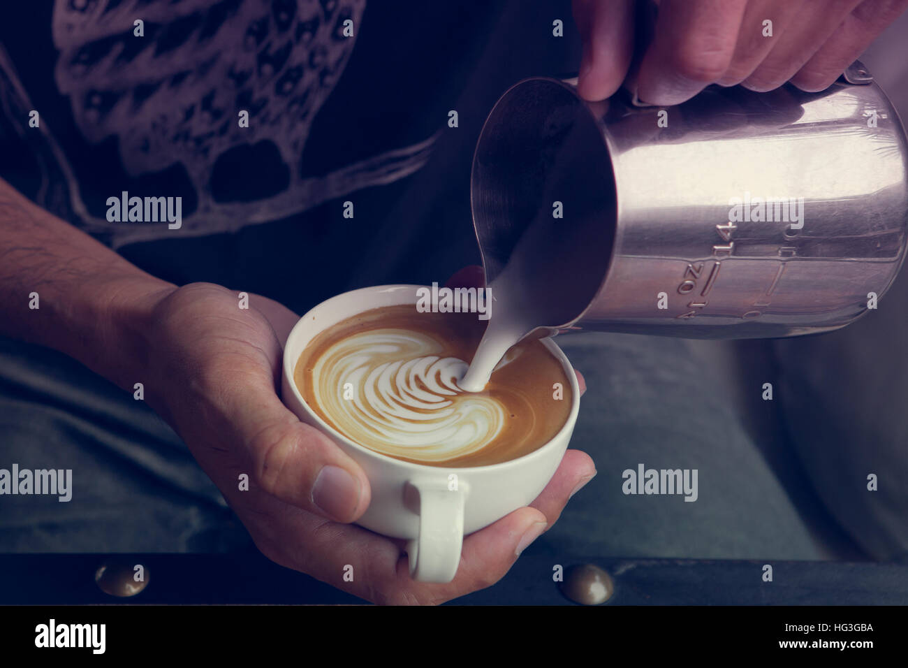 Making coffee latte art  ' Rosetta ' , Vintage tone color - Stock Image