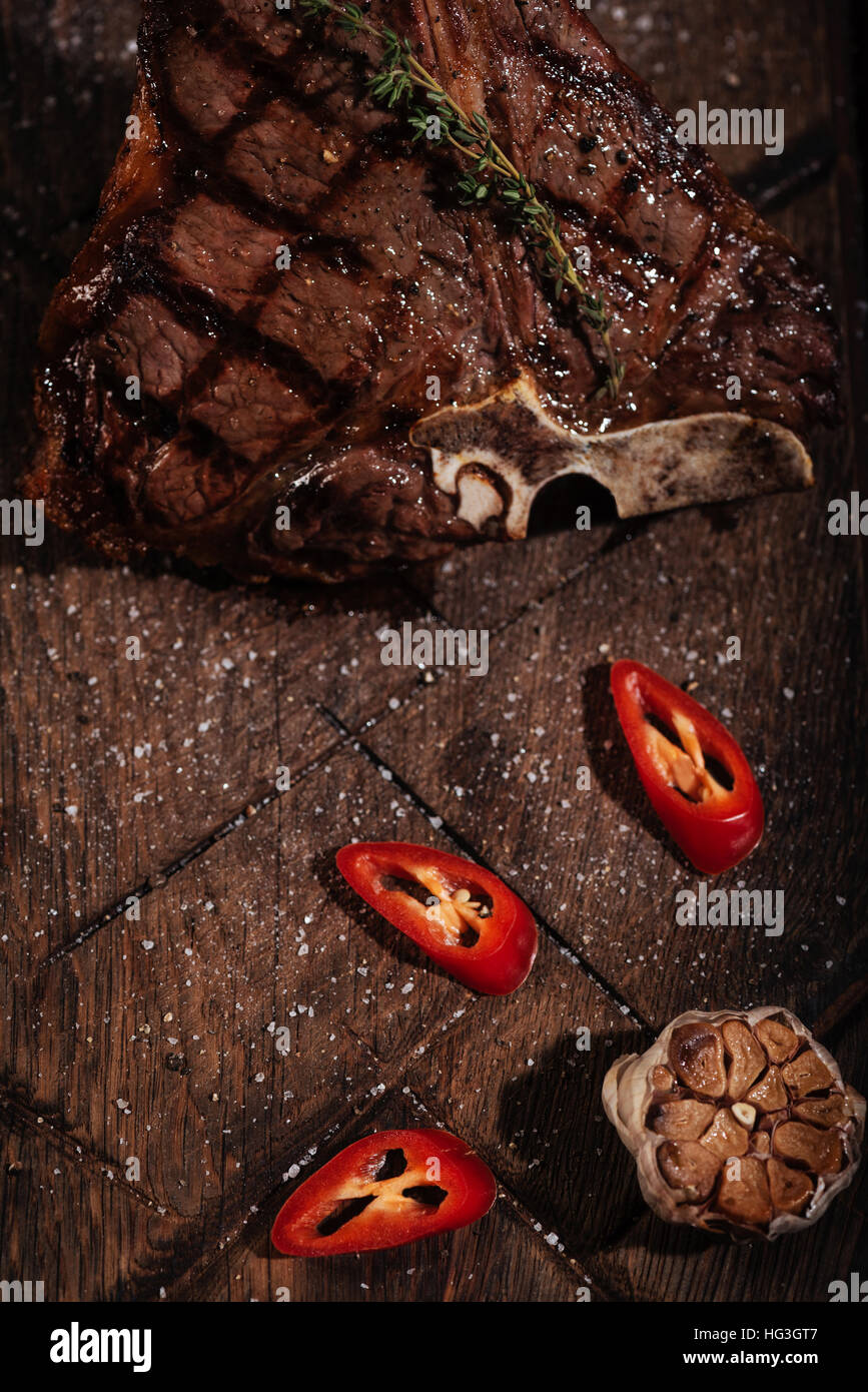 Top view of steak and vegetables lying on a table - Stock Image
