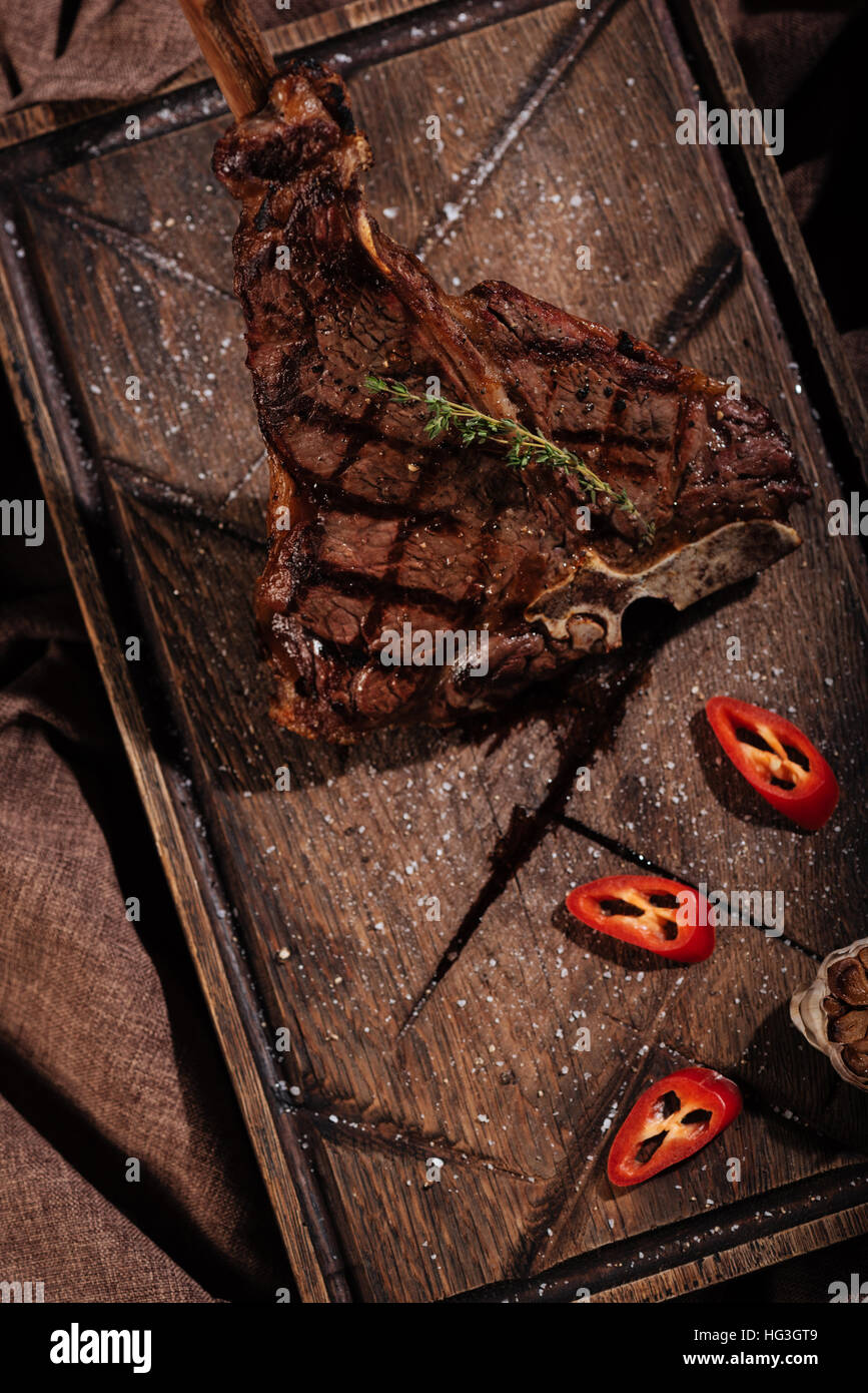 Top view of vegetables and steak being cooked on table - Stock Image