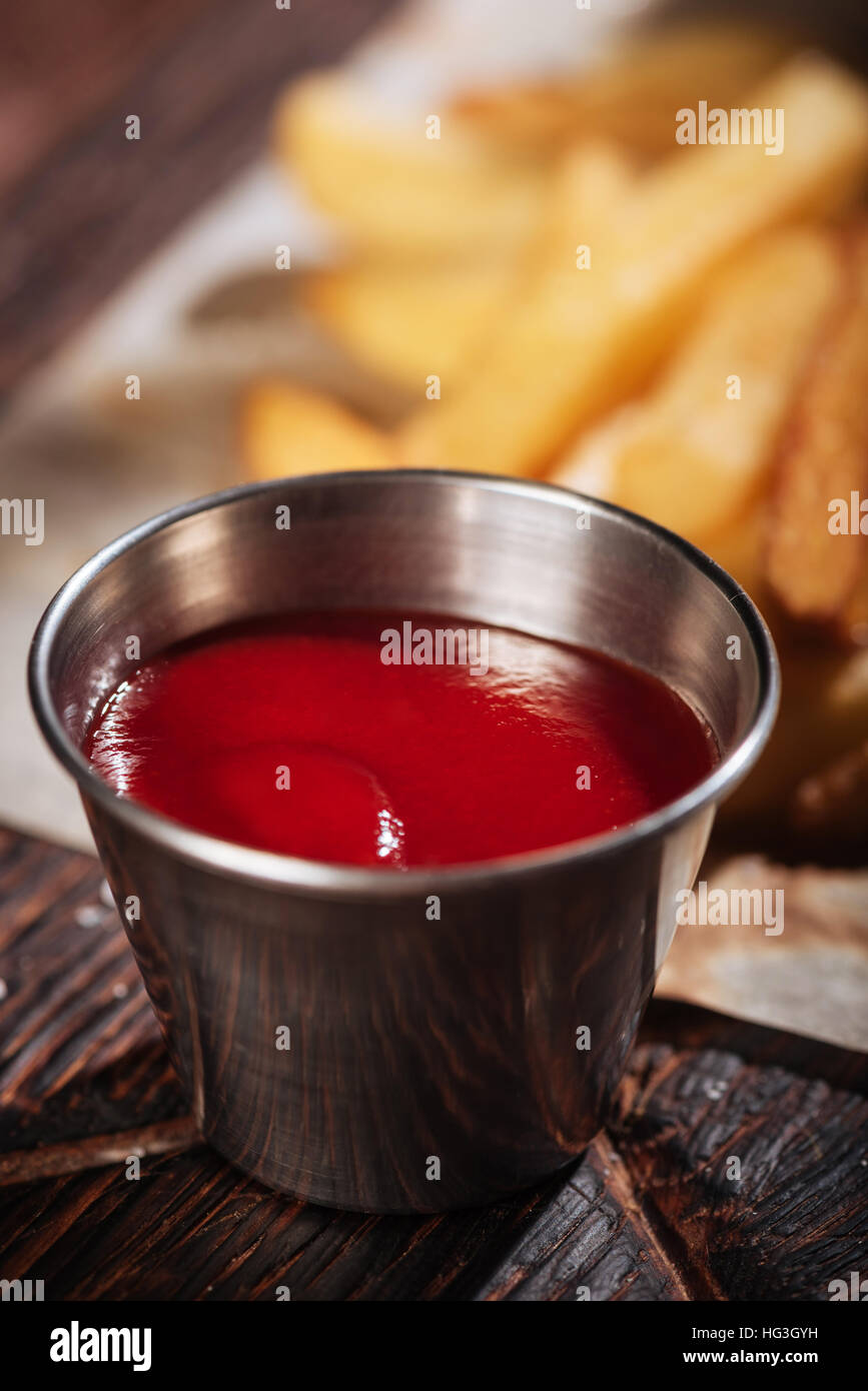 Close up of sauce being served with French fries - Stock Image