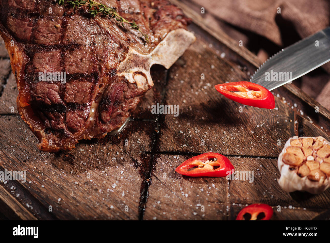 Top view of a steak being cooked with vegetables - Stock Image