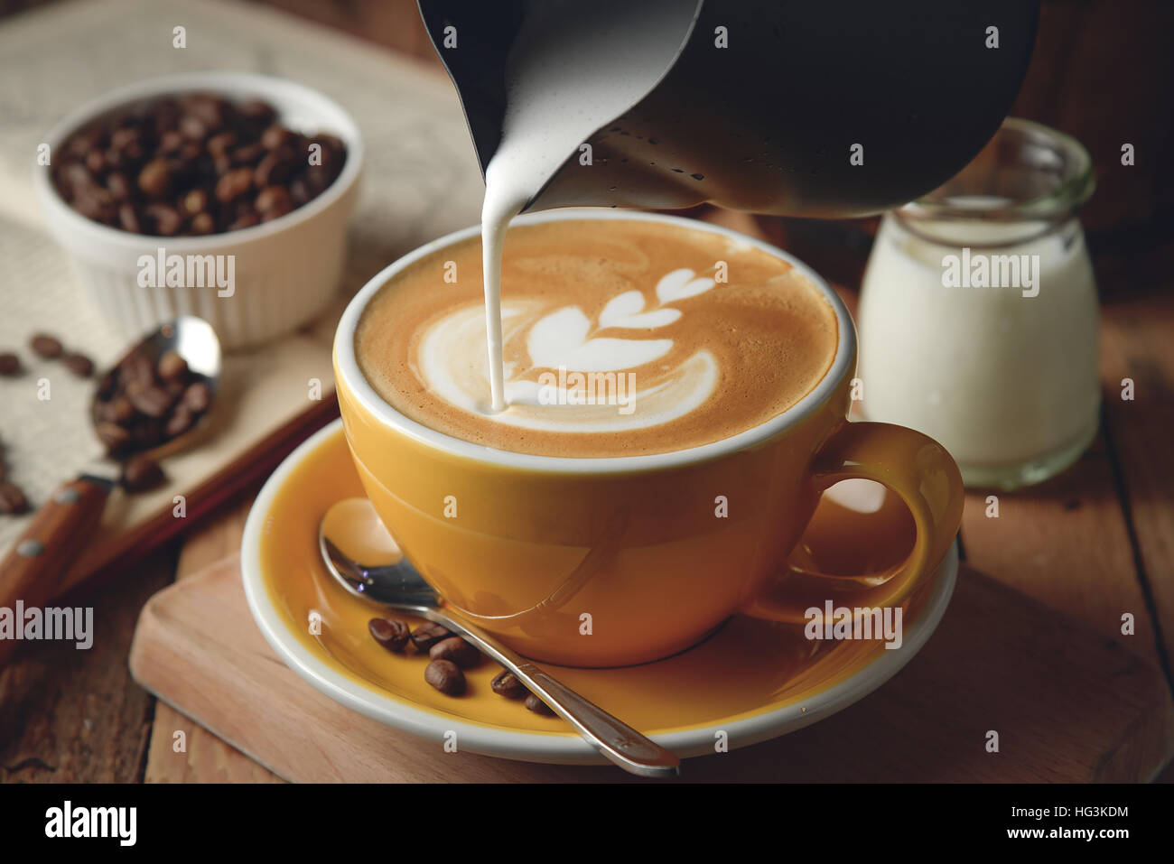 Making latte Art on a Cappuccino. Freshly made - Stock Image
